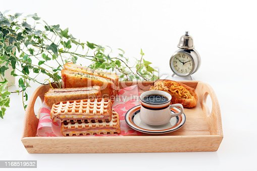 Tasty sandwiches and a cup of coffee on the table