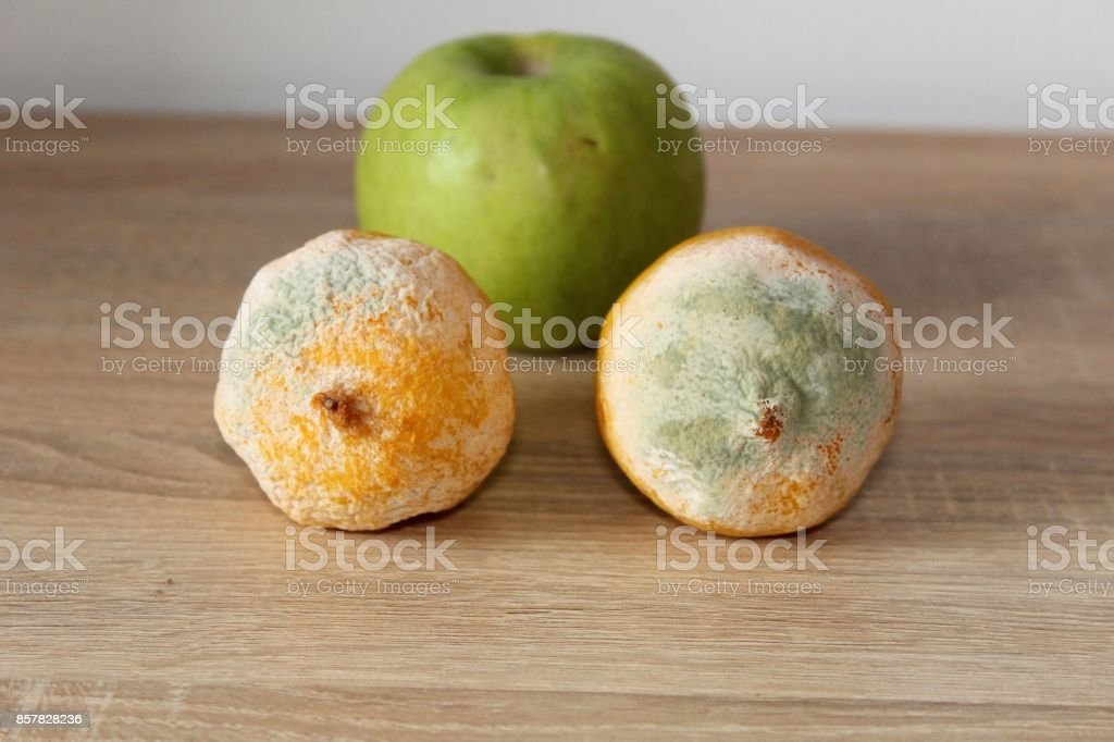 Healthy and unhealthy fruits. stock photo