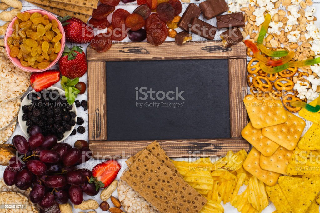 Healthy and unhealthy snacks choice stock photo