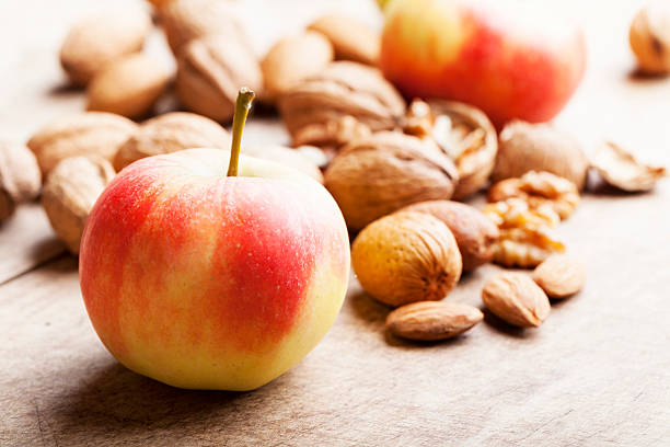 healthy apple and nut snack on rustic wood stock photo