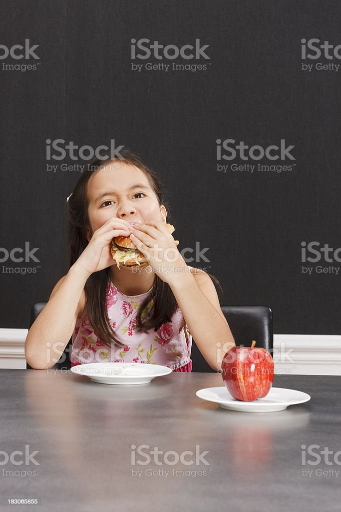 Healthy apple no, junk food yes stock photo