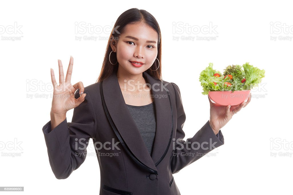 Healthy Asian business woman show OK with salad. royalty-free stock photo