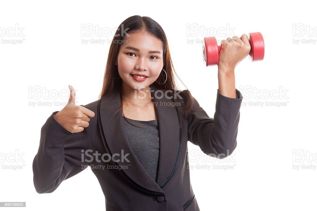 Healthy Asian business woman thumbs up with dumbbells. royalty-free stock photo