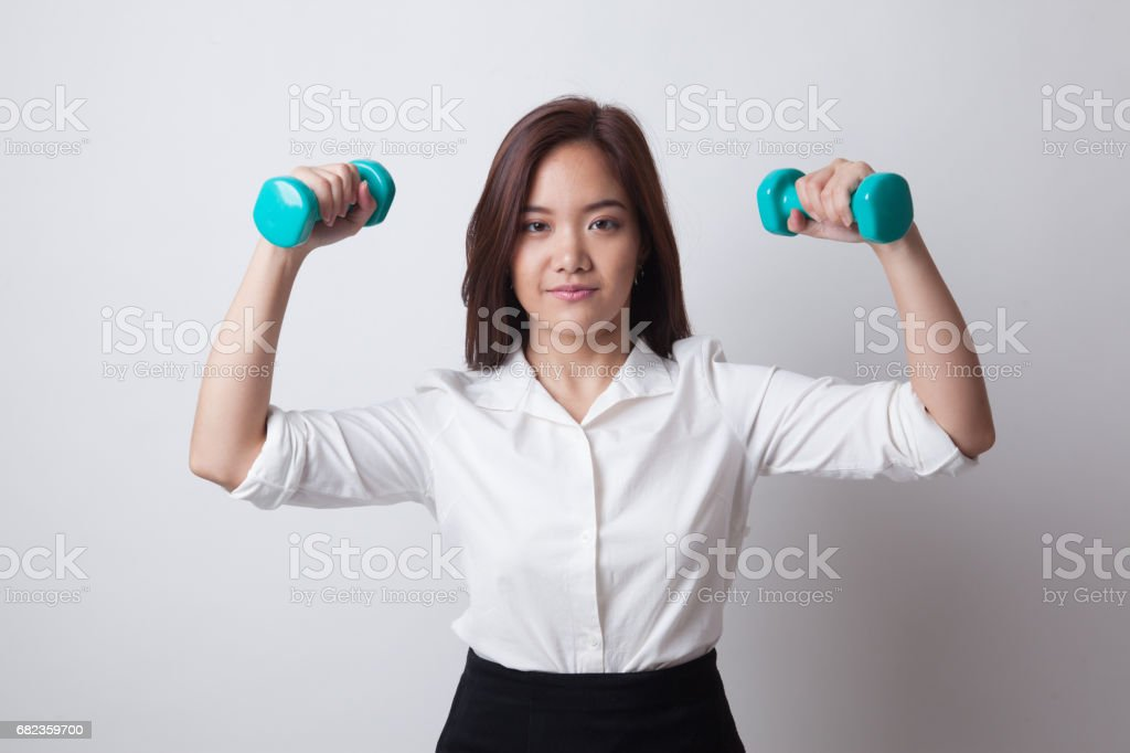Healthy Asian business woman with dumbbells. foto stock royalty-free