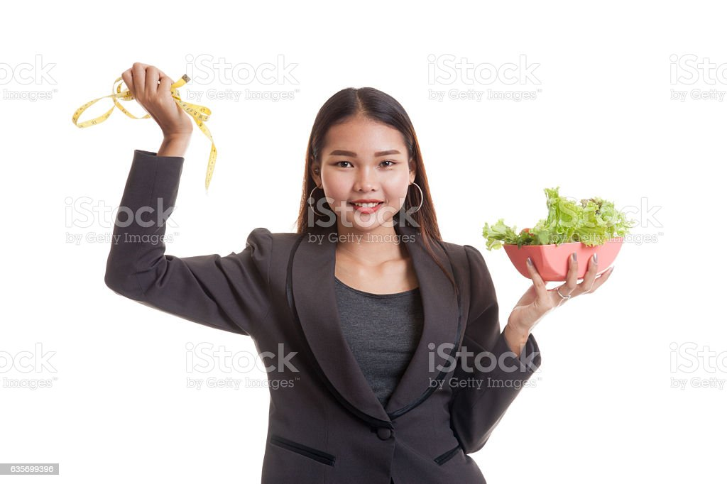 Healthy  Asian business woman with measuring tape and salad. royalty-free stock photo