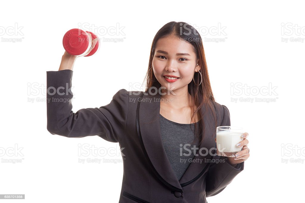 Healthy Asian woman drinking a glass of milk and dumbbell. royalty-free stock photo