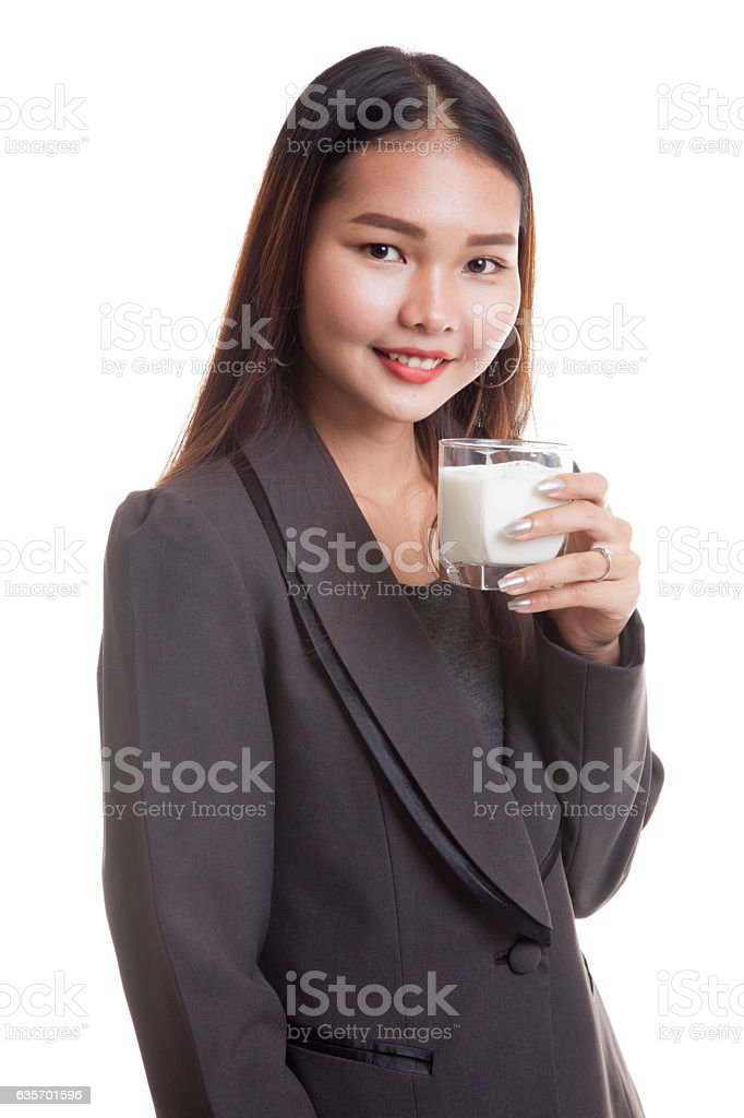 Healthy Asian woman drinking a glass of milk. royalty-free stock photo