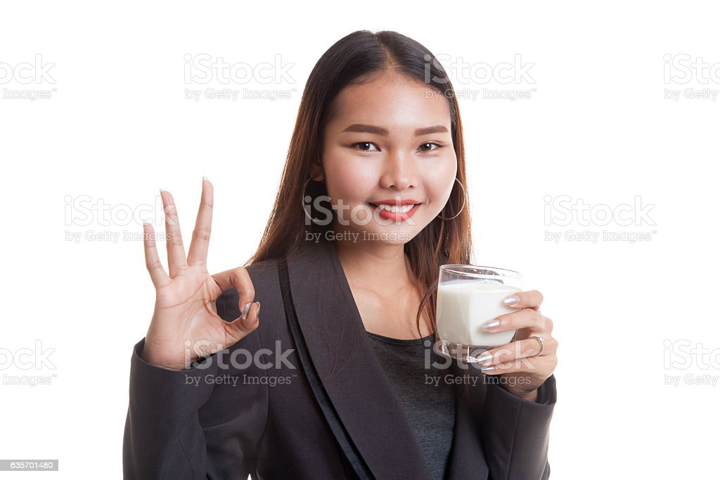 Healthy Asian woman drinking a glass of milk show OK royalty-free stock photo