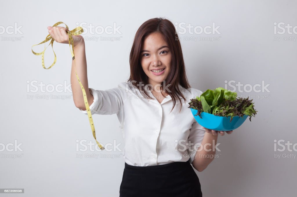 Healthy  Asian woman with measuring tape and salad. foto stock royalty-free
