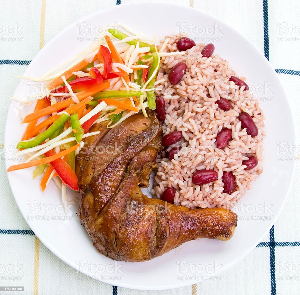 A healthy balanced meal Caribbean style with jerk chicken stock photo