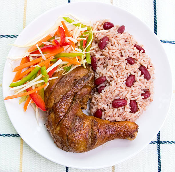 a healthy balanced meal caribbean style with jerk chicken - caribbean food stock photos and pictures