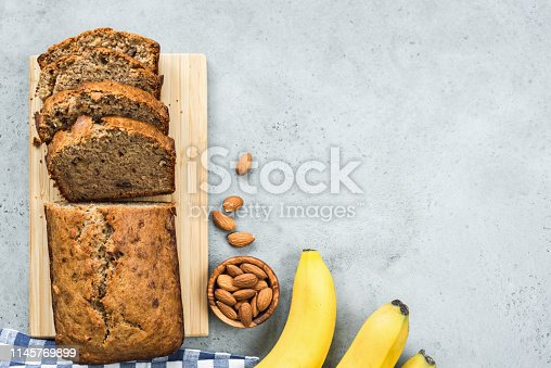 istock Healthy banana bread loaf on concrete background top view 1145769899