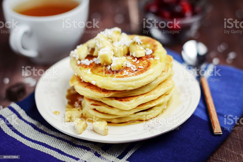 Healthy banana pancakes with coconut flakes stock photo