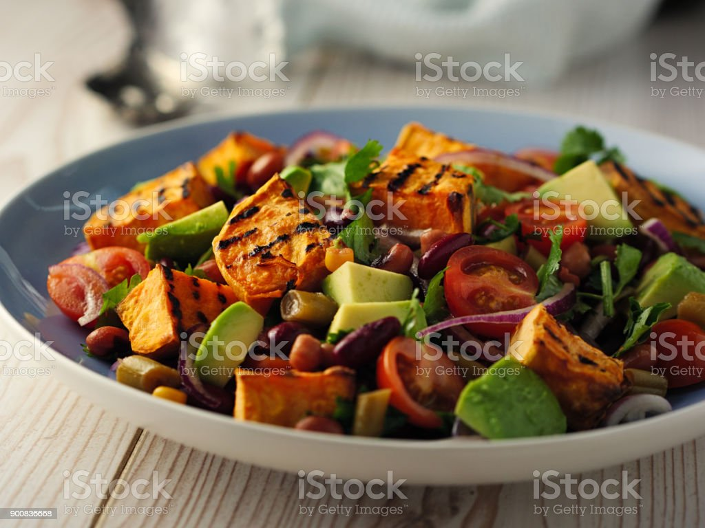 Healthy beans salad with grilled sweet potatoes stock photo