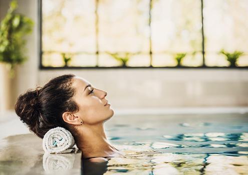 Happy woman at the spa enjoying life