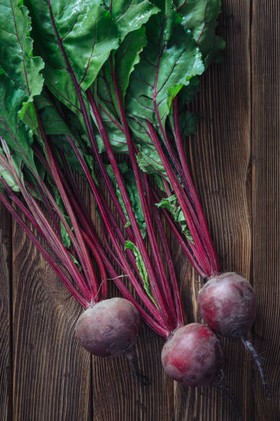 Healthy beetroot with leaves on rustic wooden background stock photo