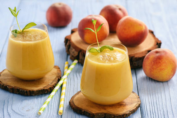 Healthy beverage - fresh blended peach smoothie. stock photo