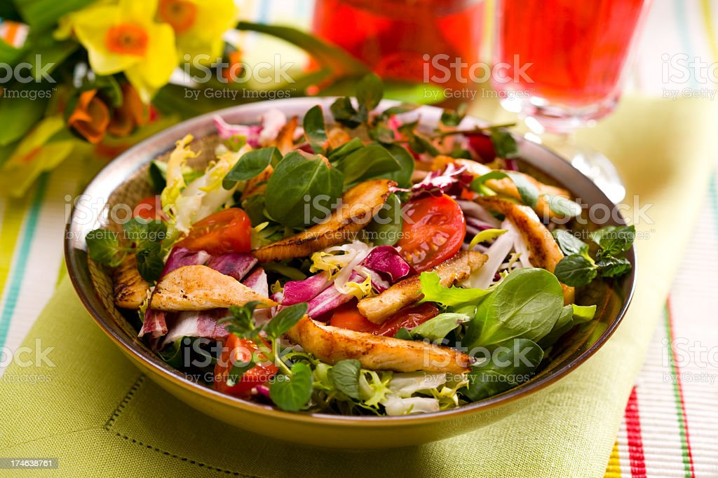 A healthy bowl of Caesar salad stock photo