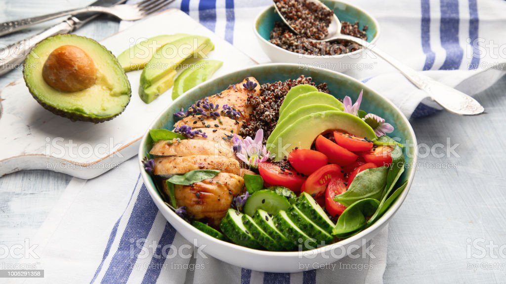 Healthy bowl with roasted chicken and quinoa stock photo