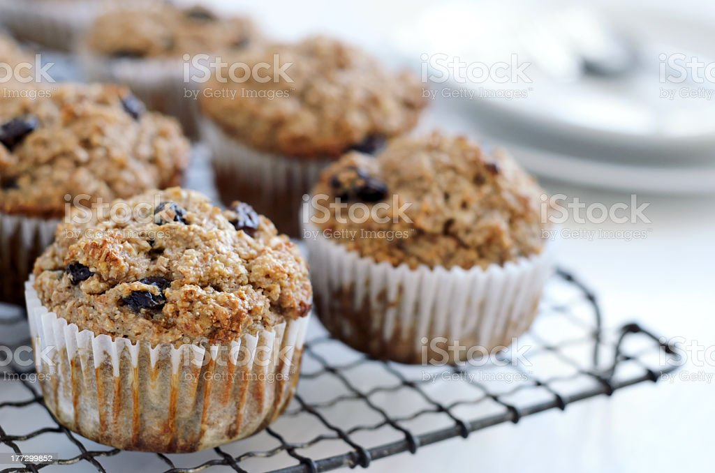 Healthy bran muffins on cooling tray stock photo