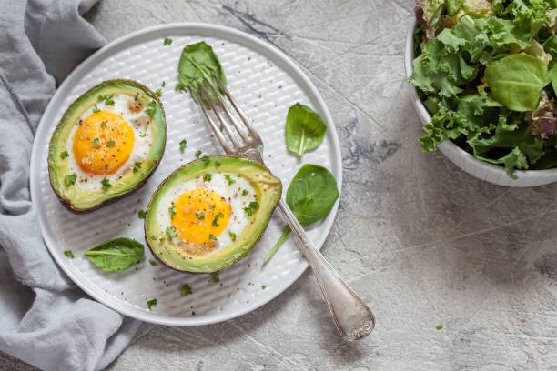 healthy breakfast. avocado stuffed with eggs - egg stock pictures, royalty-free photos & images