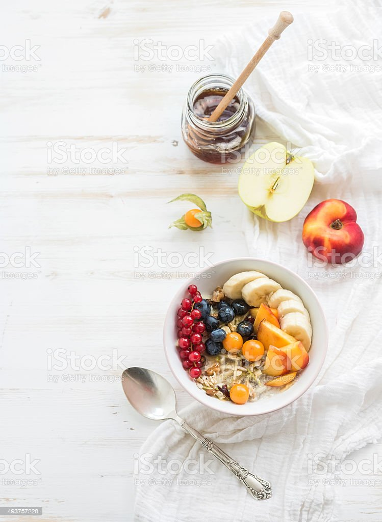 Healthy breakfast. Bowl of oat granola with yogurt, fresh berries stock photo