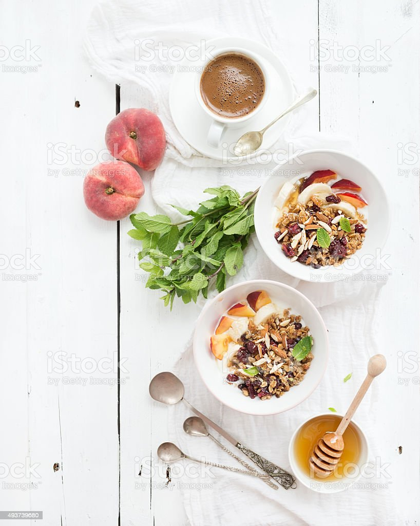Healthy breakfast. Bowl of oat granola with yogurt, fresh fruit stock photo
