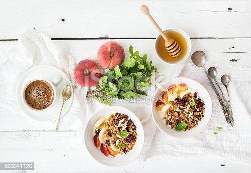 istock Healthy breakfast. Bowl of oat granola with yogurt, fresh fruit 523241120
