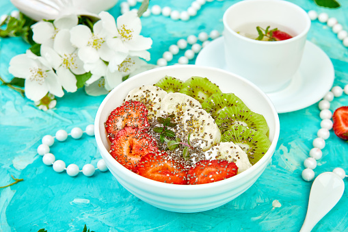 840939766 istock photo Healthy breakfast bowl smoothie with strawberry, banana, kiwi  and chia seeds. 1162725763