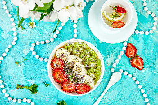 840939766 istock photo Healthy breakfast bowl smoothie with strawberry, banana, kiwi  and chia seeds. 1162725819