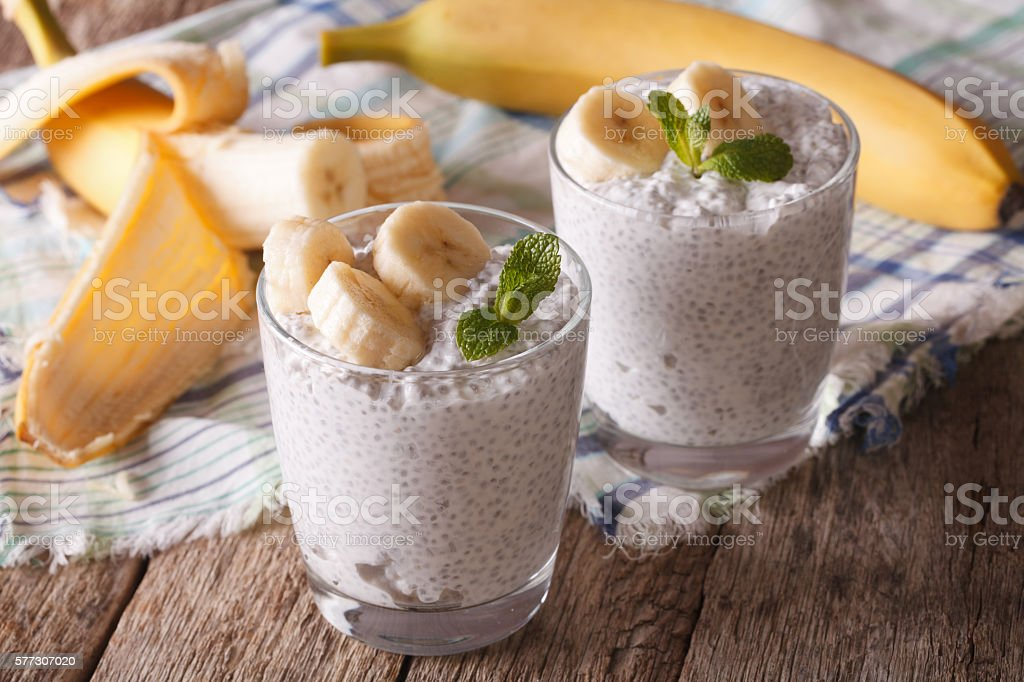 Healthy breakfast: chia seed pudding with banana on the table stock photo