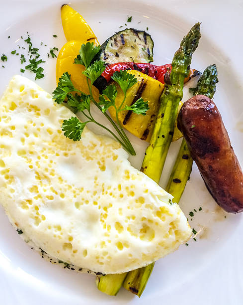 Healthy Breakfast: egg whites omelette with veggies and sausage Healthy Breakfast: egg whites omelette with veggies and sausage egg white stock pictures, royalty-free photos & images