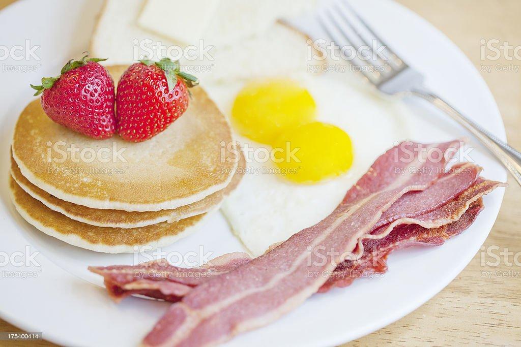 Healthy Breakfast Eggs, Turkey Bacon, Pancakes and Toast Close Up stock photo
