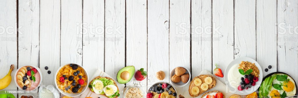 Healthy Breakfast Food Banner With Bottom Border Of Fruits Yogurt Smoothie  Bowl Nutritious Toasts Cereal And Egg Skillet Top View Over A White Wood  Background Stock Photo - Download Image Now - iStock