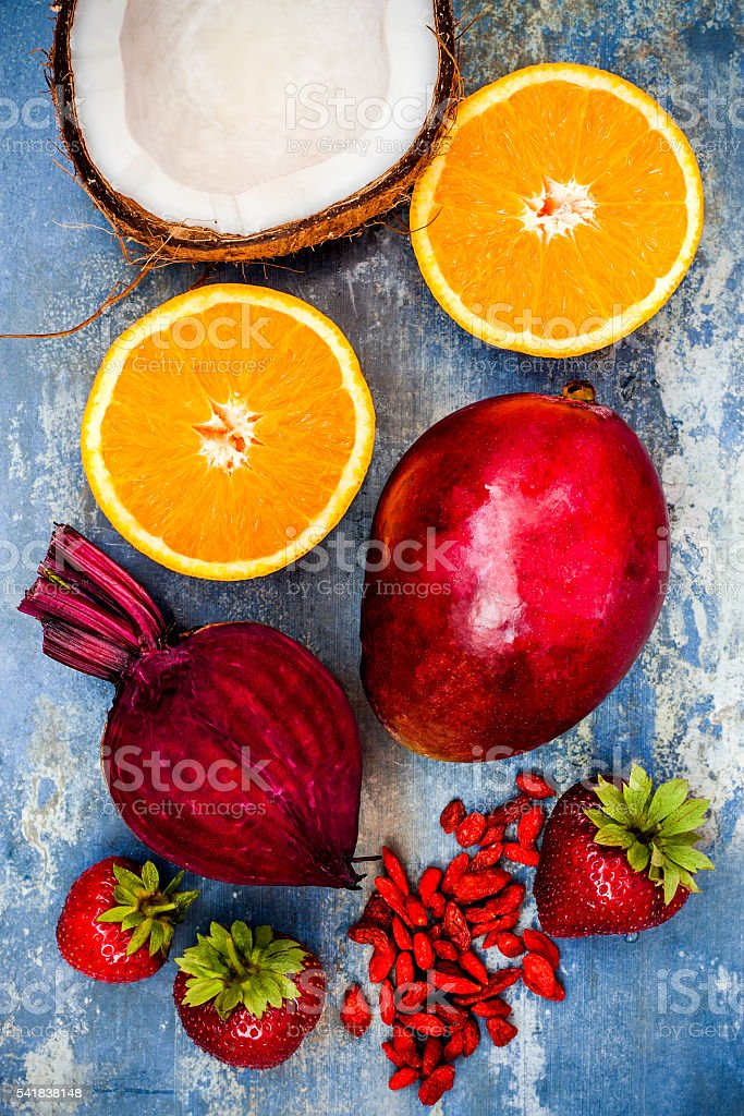 Healthy breakfast food collage. Mango goji berry smoothie recipe stock photo