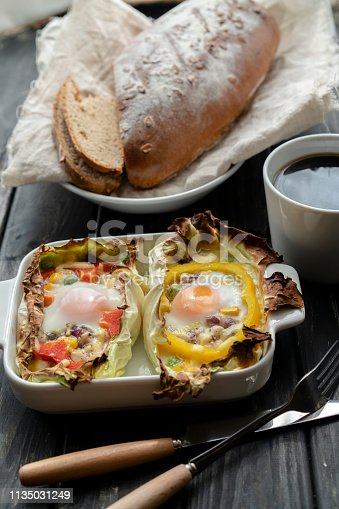 healthy breakfast: homemade bread and baked egg in cabbage leaf