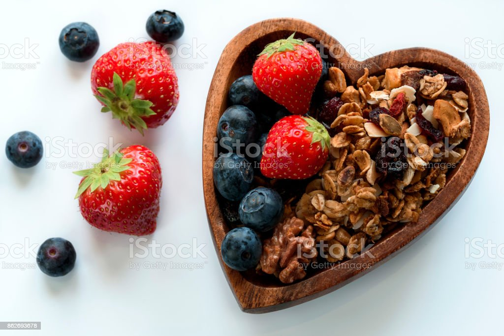 Healthy breakfast: homemade gramola with fresh blueberry and str stock photo