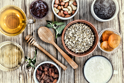 840939766 istock photo Healthy breakfast. Ingredients for muesli or granola in multi-colored bowls. Top view. 884903640