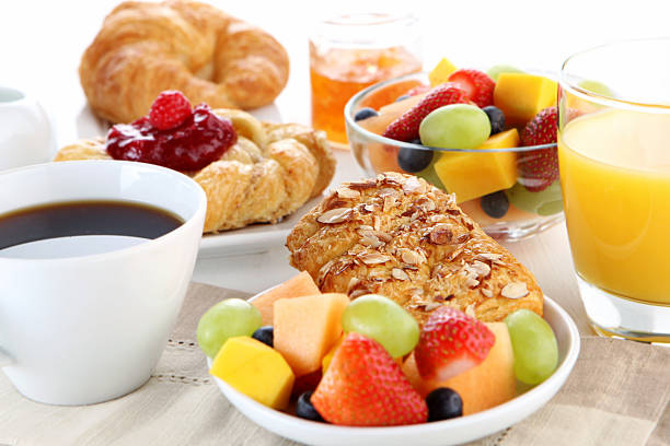 A healthy breakfast laid out at the table with coffee stock photo