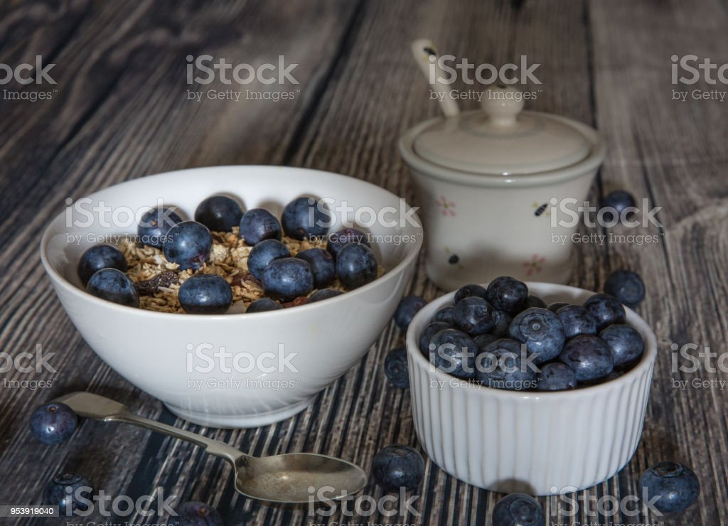 A healthy breakfast of granola and blueberries stock photo