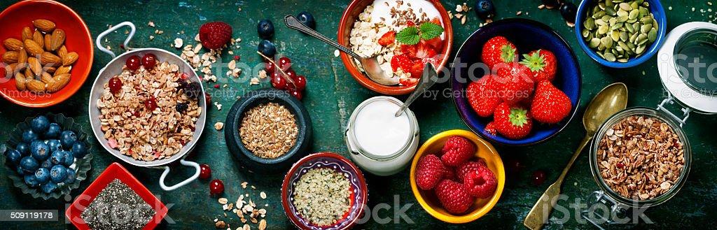 Healthy breakfast of muesli, berries with yogurt and seeds stock photo