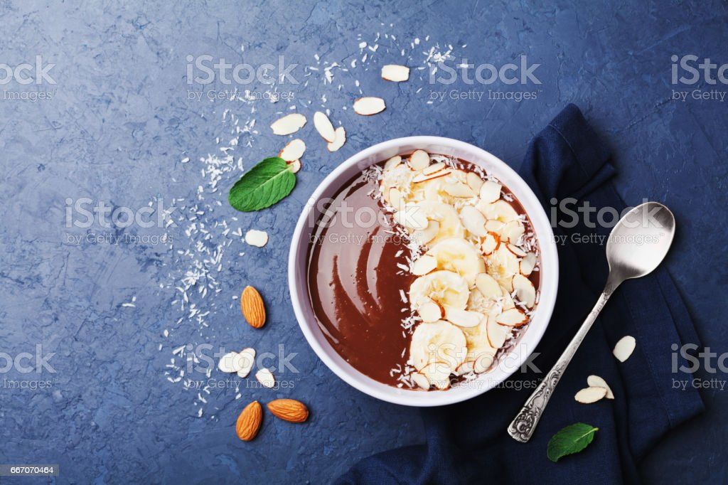 Healthy breakfast or dessert. Flat lay. Chocolate banana almond coconut smoothie. stock photo