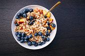 istock Healthy breakfast - organic porridge with fruits 1007993400