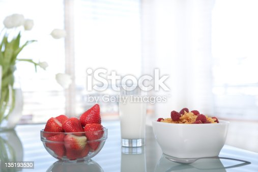 Strawberries and milk on table
