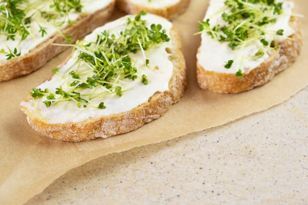 Healthy breakfast. Sandwich with cream cheese and microgreens. stock photo