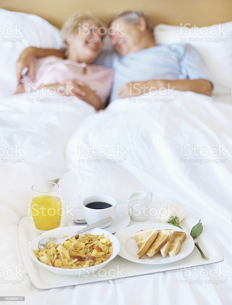 Healthy breakfast served to a couple in bed royalty-free stock photo
