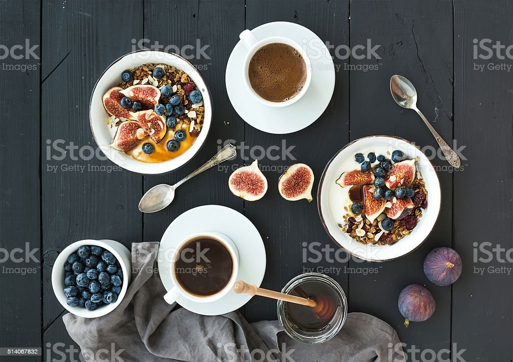 Healthy breakfast set. Bowls of oat granola with yogurt, fresh stock photo