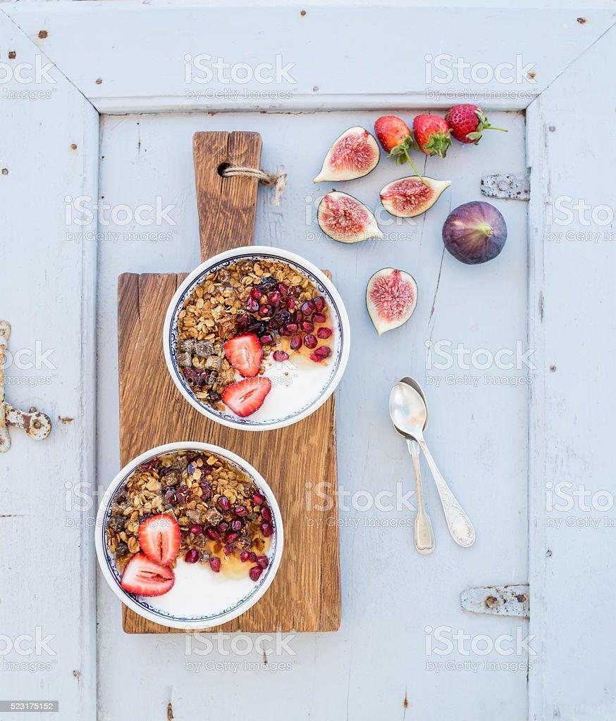 Healthy breakfast set. Bowls of oat granola with yogurt, fresh stock photo