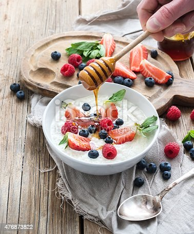904734850istockphoto Healthy breakfast set. Rice cereal or porridge with berries and 476873822
