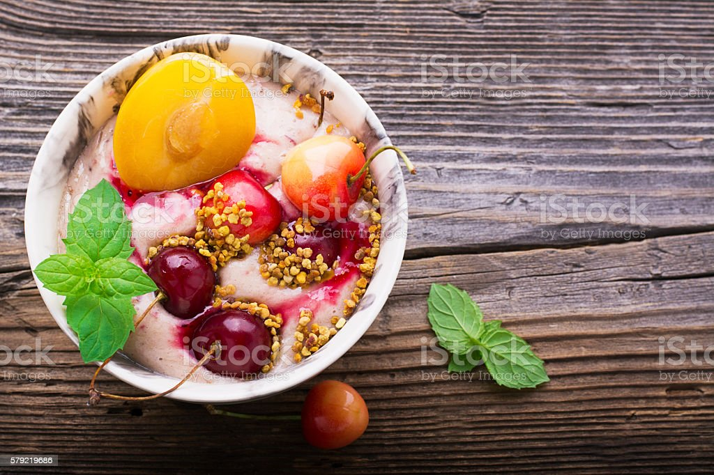 Healthy breakfast snack. Marble Portion bowl full of cherry smoothie stock photo